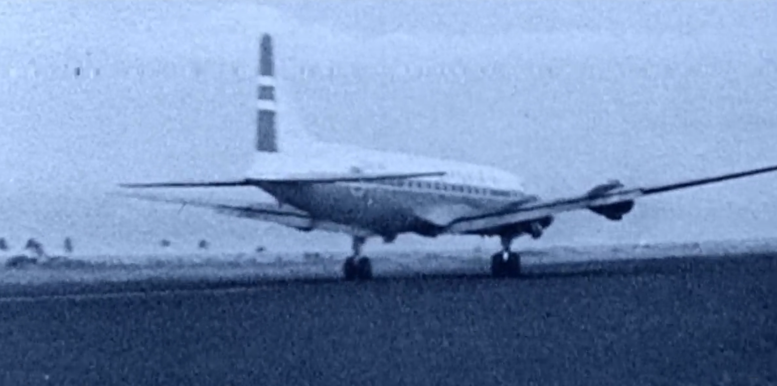 Black and white photo of propeller plane from the 1960's