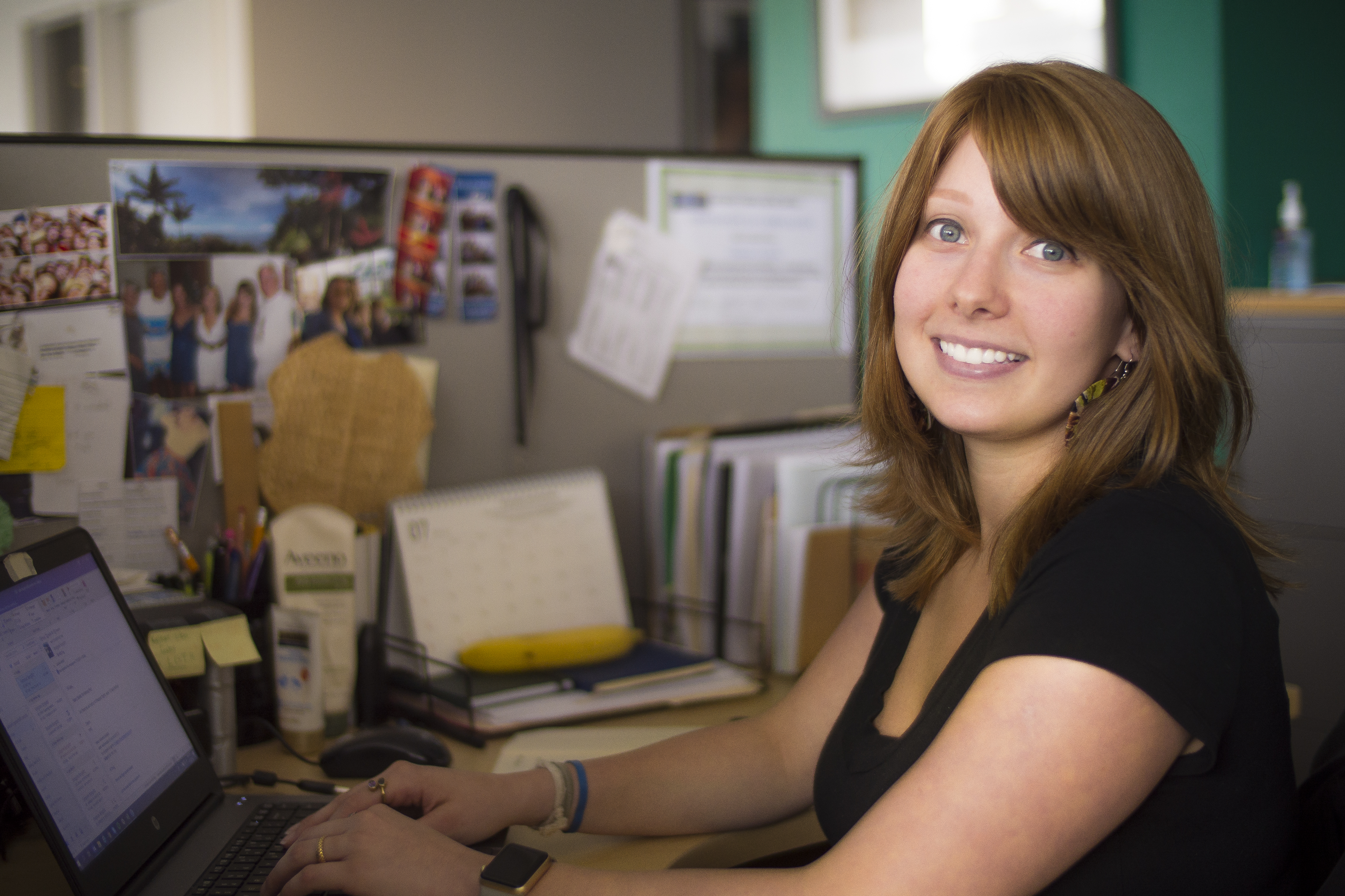 Woman sitting at cubicle desk
