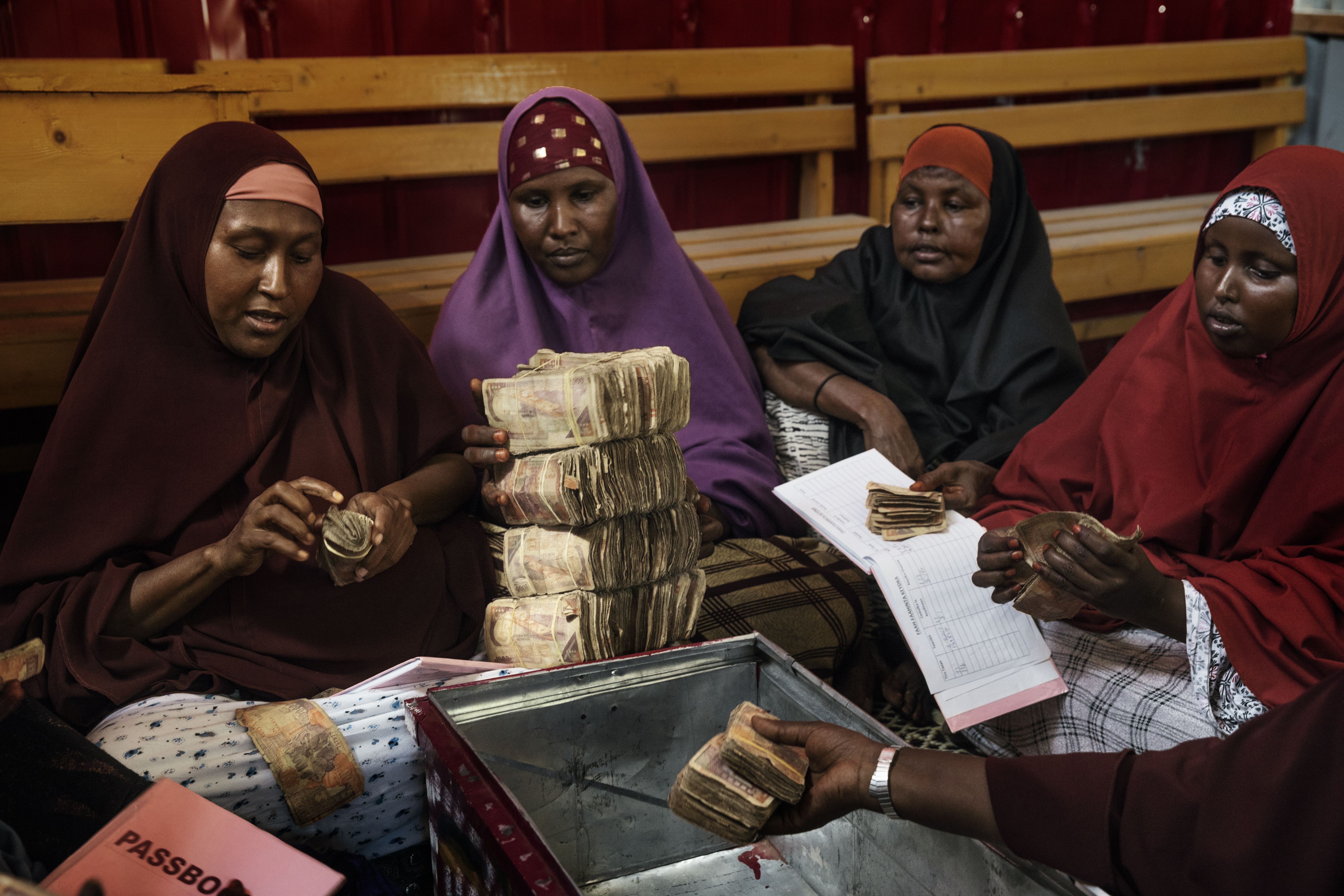 Group of women in Mogadishu counting money.