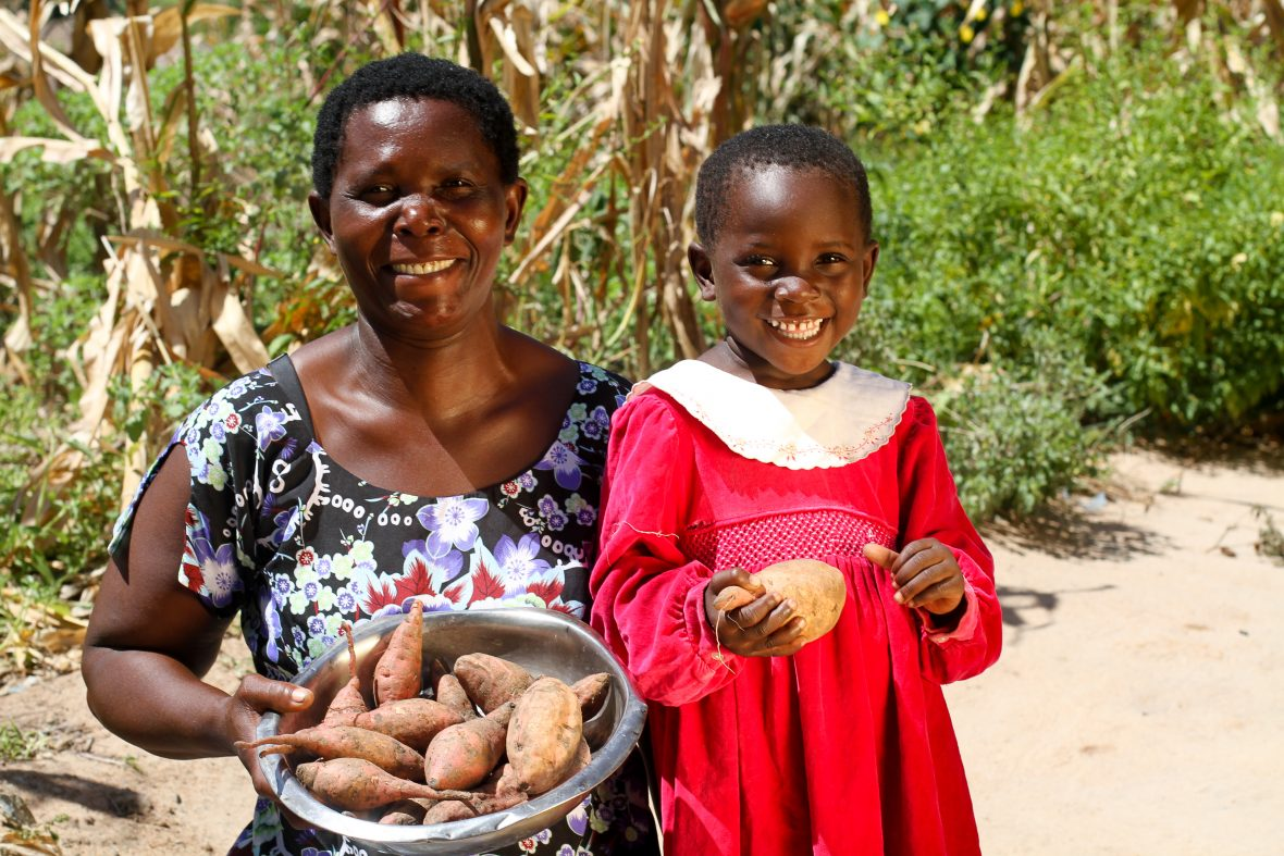 A woman and her daughter with sweet potatoes in Malawi