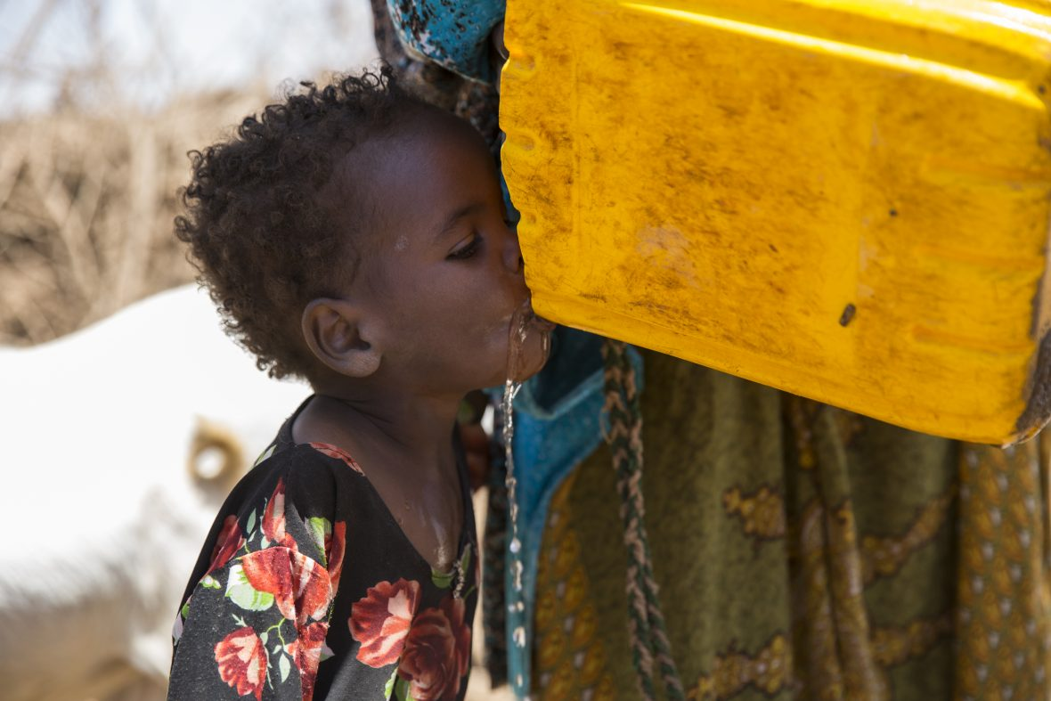A young girl drinks water in Somaliland