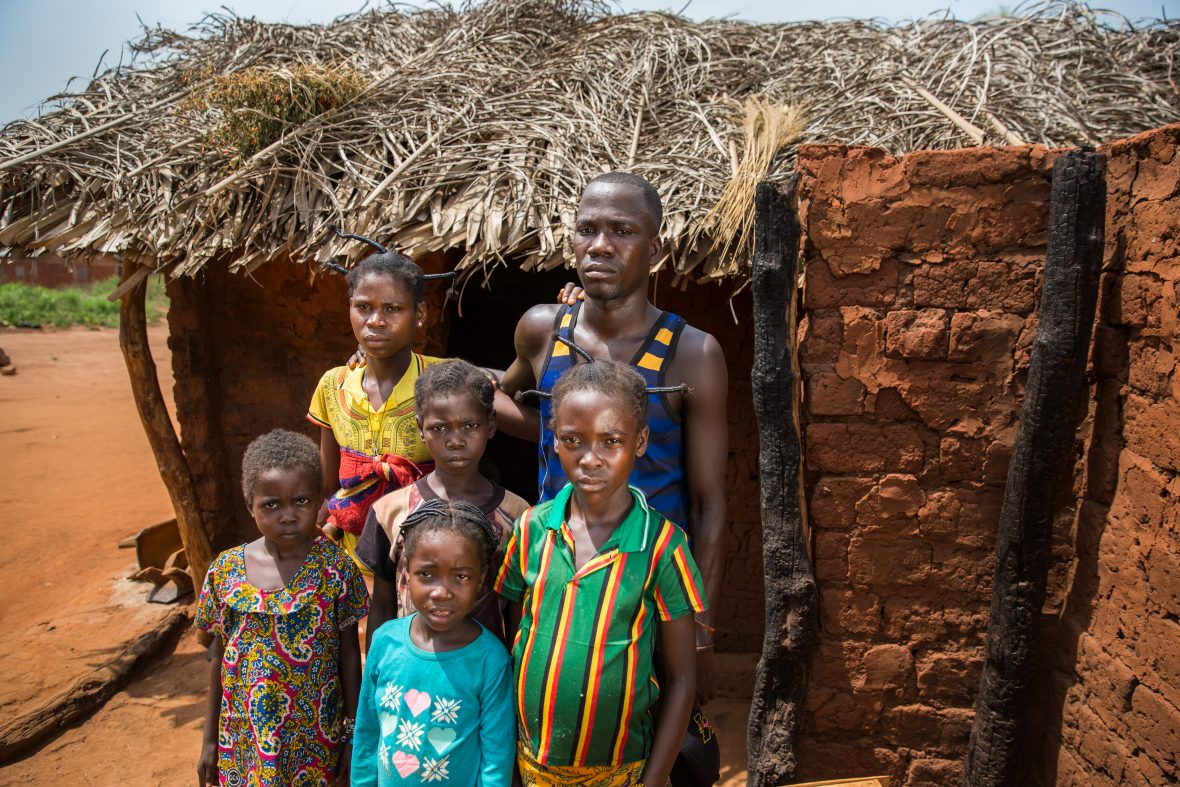 A family outside their rebuilt home in Central African Republic
