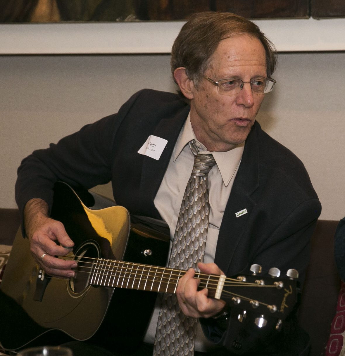 Professor Keith West playing for ex-colleagues at a Concern reunion in Ireland in 2018.