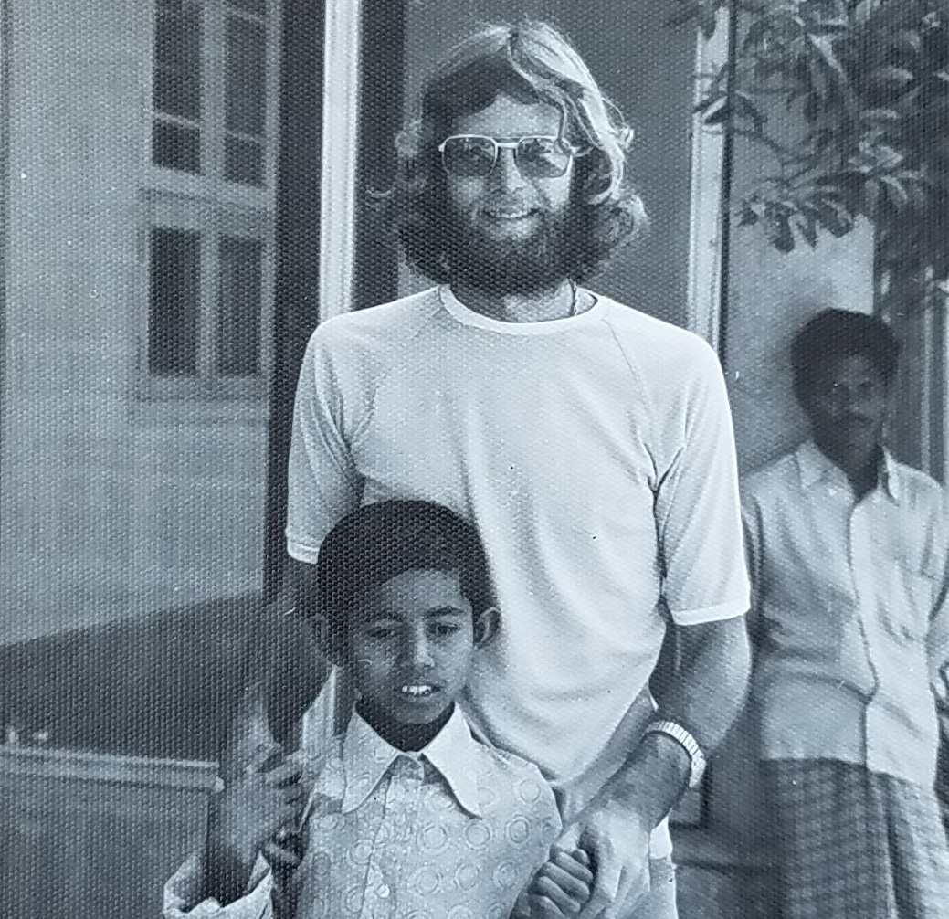 Keith West with one of the Bangladesh children taking part in Concern's nutrition program.