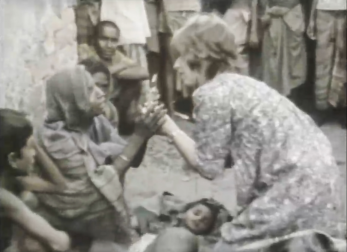 A Concern volunteer comforts the mother of a severely ill child, Bangladesh 1977.