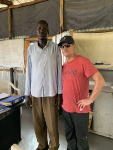 Niall O'Brien (right) stands with Peter, a refugee working as a translator in the camp.