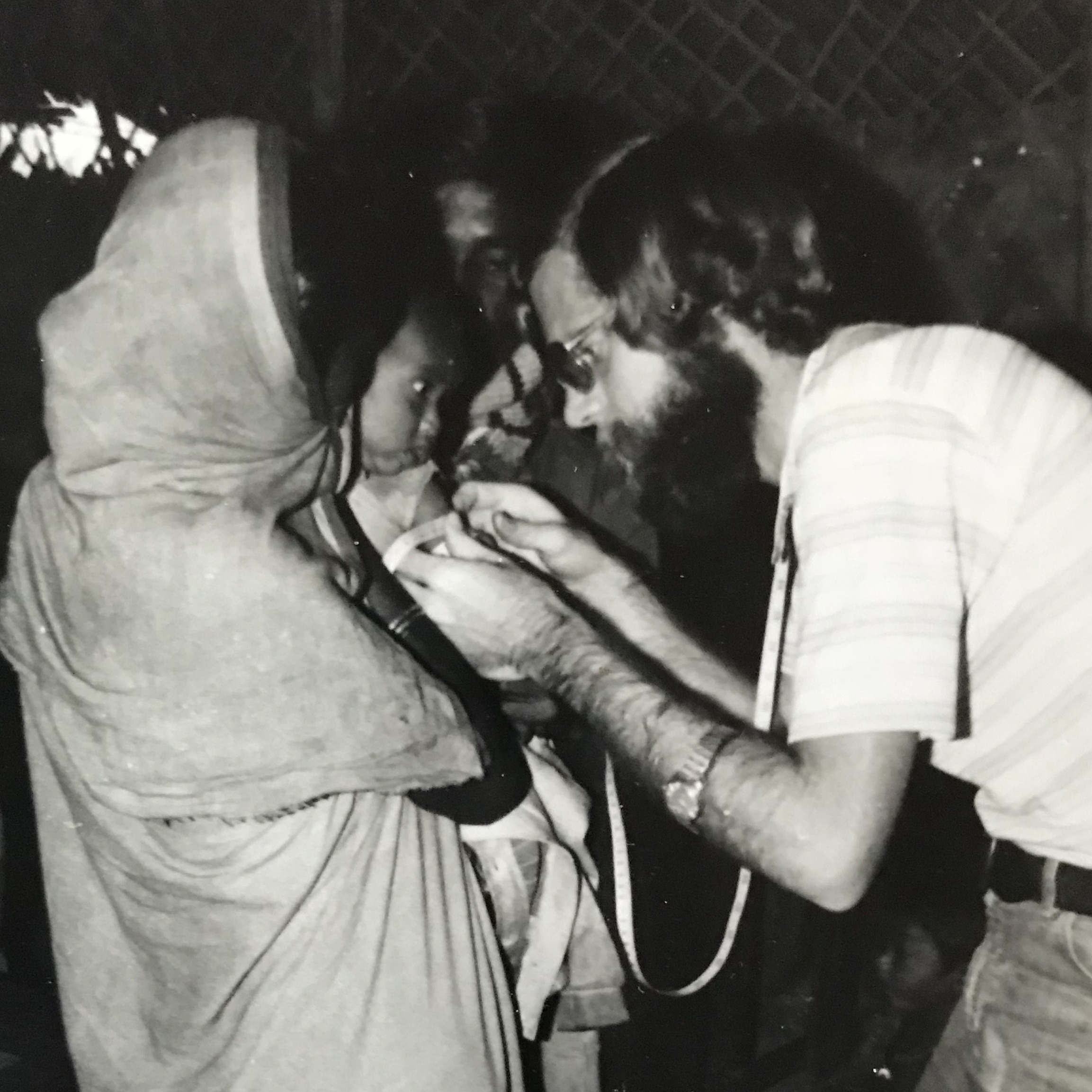 eith West, checking a young Bangladeshi for signs of malnutrition at a Concern clinic in the 1970s.
