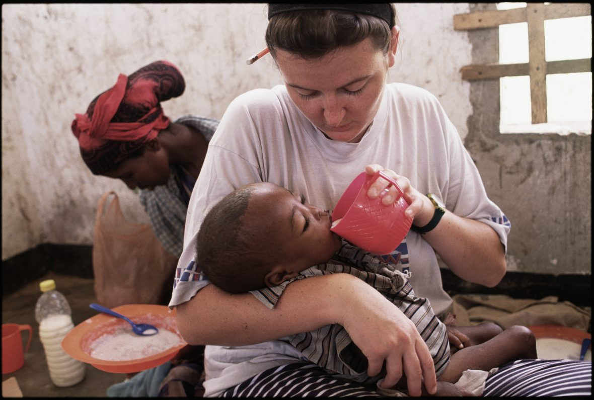 Irish nurse, Valerie Place, feeds a starving child during the Somalia famine in 1993. Soon after this photo was taken, Valerie was killed in an ambush outside Mogadishu.