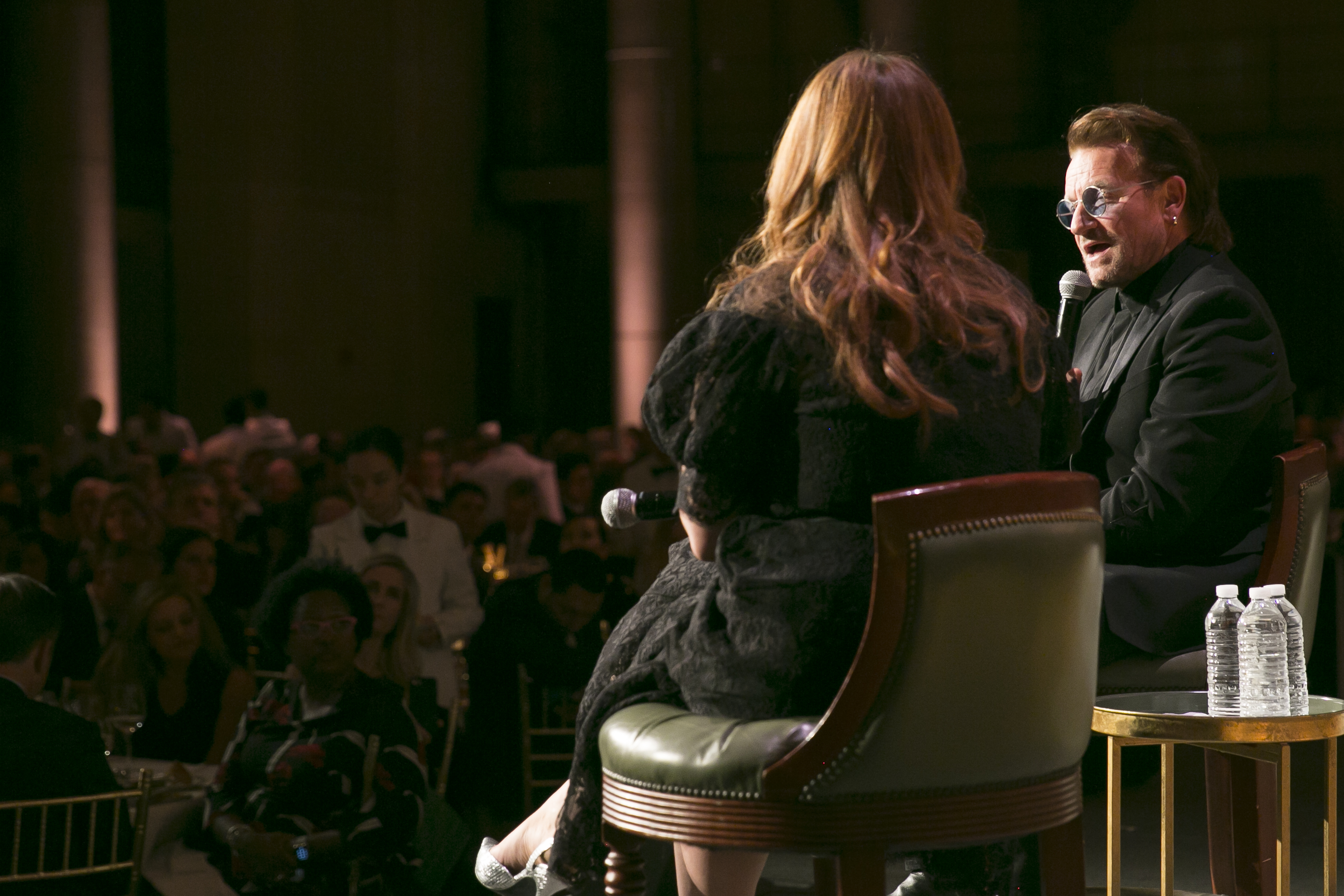 Poverty activist and musician, Bono, onstage at a Concern fundraising event in New York.