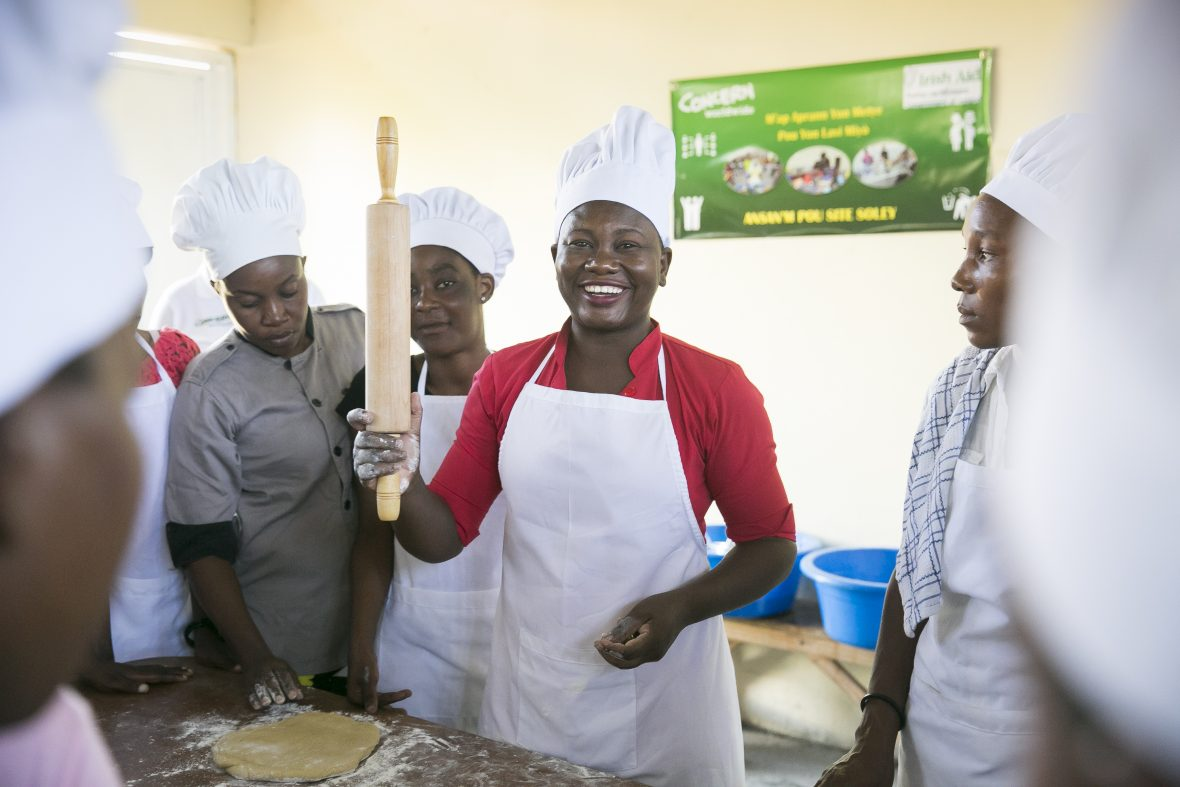 """Dolores Remy leads a professional skills training course, part of the """"Building Hope & Opportunities in Haiti"""" integrated urban program in Cité Soleil, Port au Prince"""