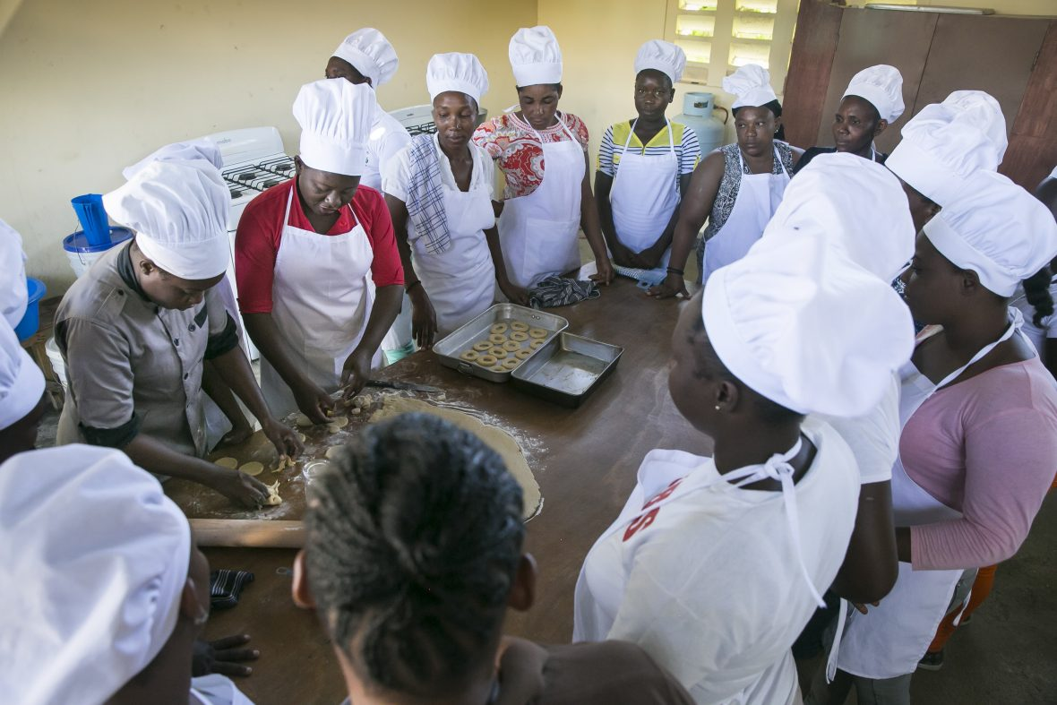 """Young women taking part in a professional skills training course, part of the """"Building Hope & Opportunities in Haiti"""" integrated urban program in Cité Soleil, Port au Prince"""