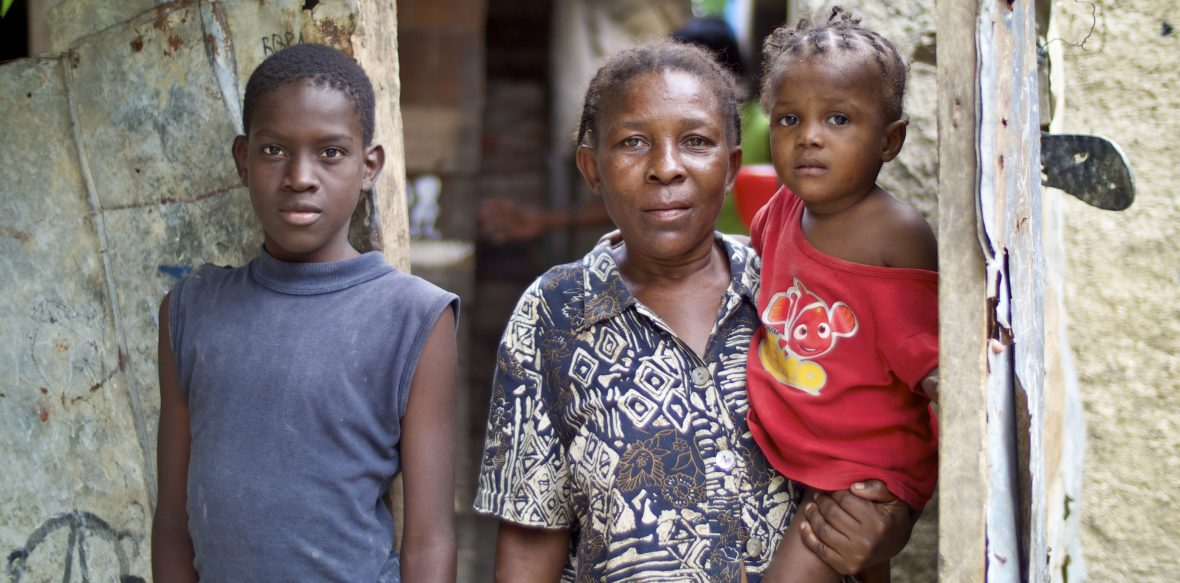 Daniela Paul and her family at their home in one of Haiti's urban slums.