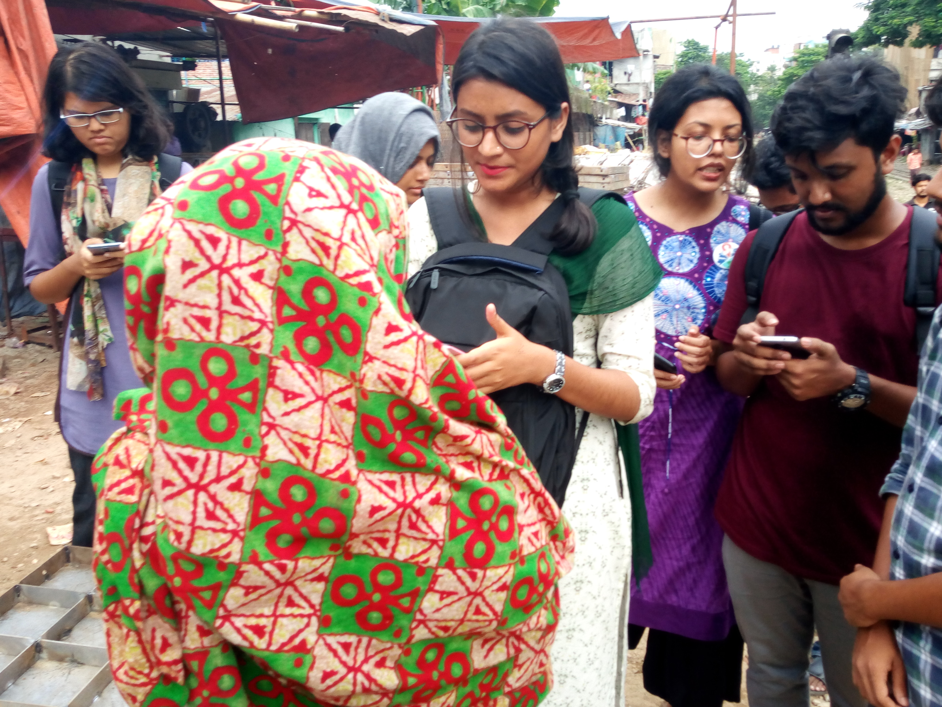 University of Dhaka students collecting the data from the internal displaced female respondents about the mental stress situation in the Moghbazer Slum area.