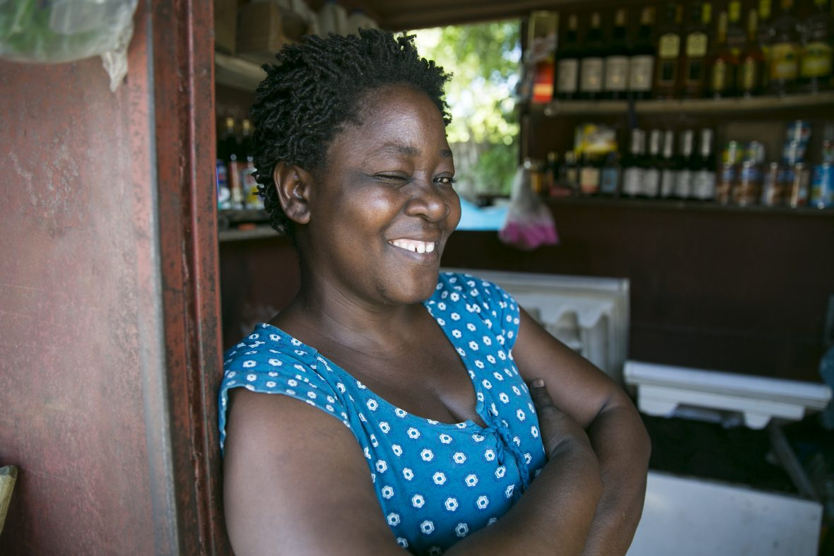 """Lunes Duvil, a small business owner who has benefited from Concern's """"Building Hope & Opportunities in Haiti"""" integrated urban program in Cité Soleil, Port au Prince. She says she has expanded and developed her range of products and the size of her shop, as a result of the program."""