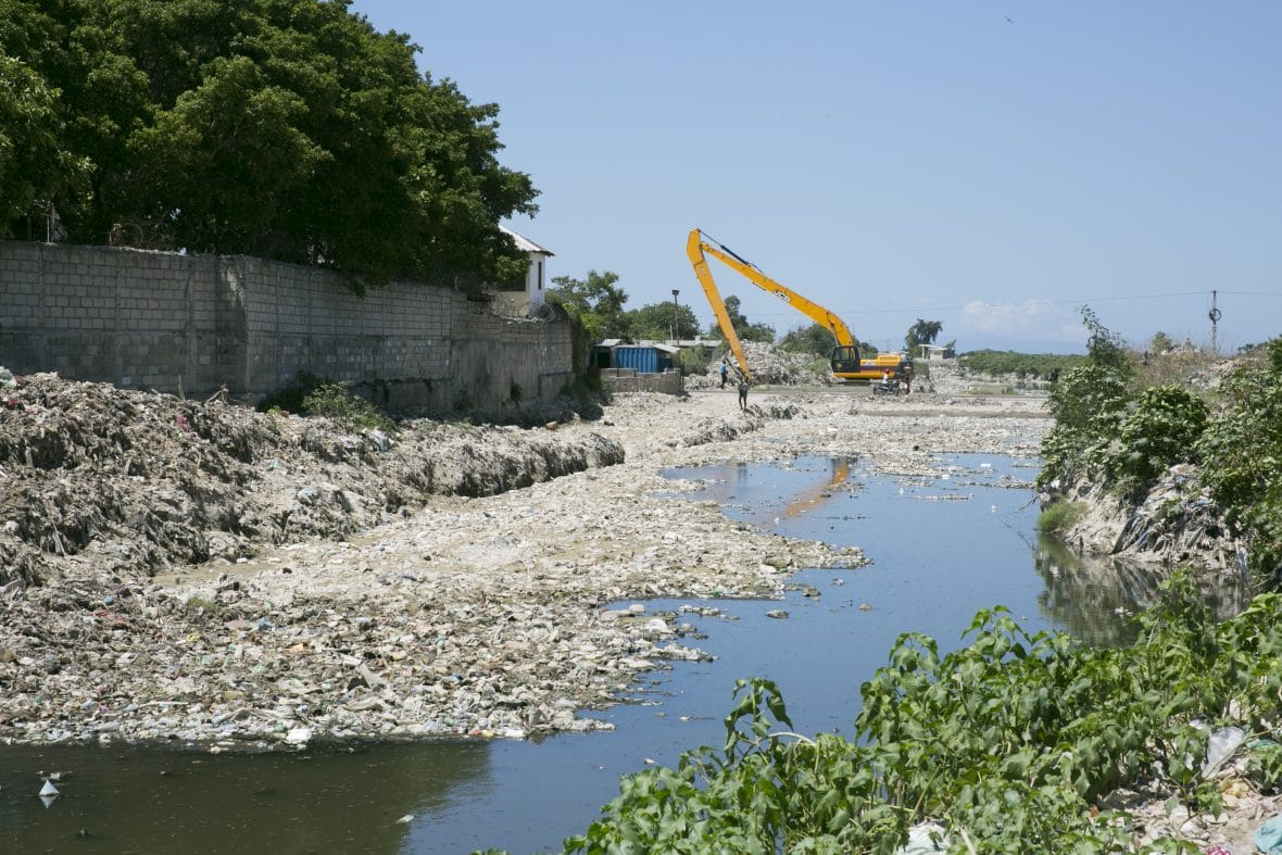 Clearance work on the waterways of Port au Prince, which have become badly clogged by plastic and other refuse.