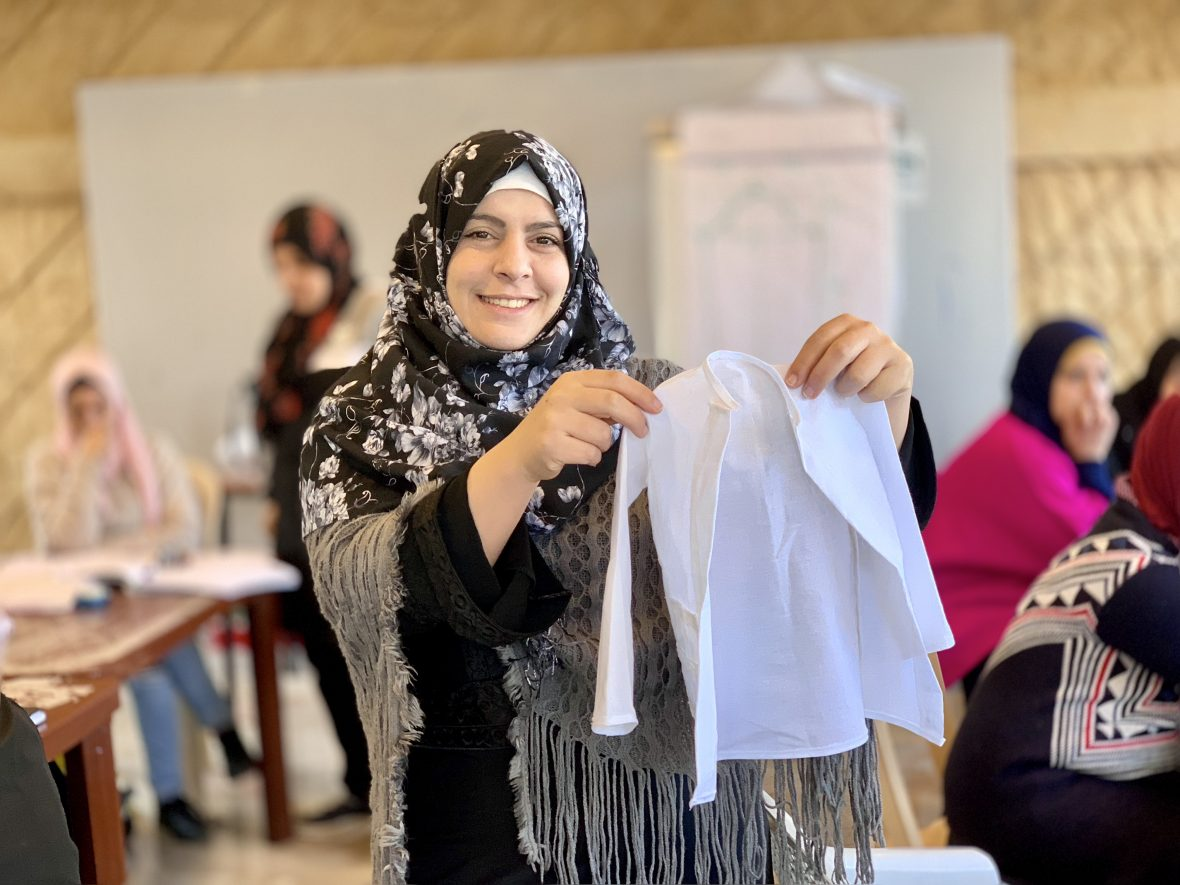 A Syrian refugee taking part in embroidery training