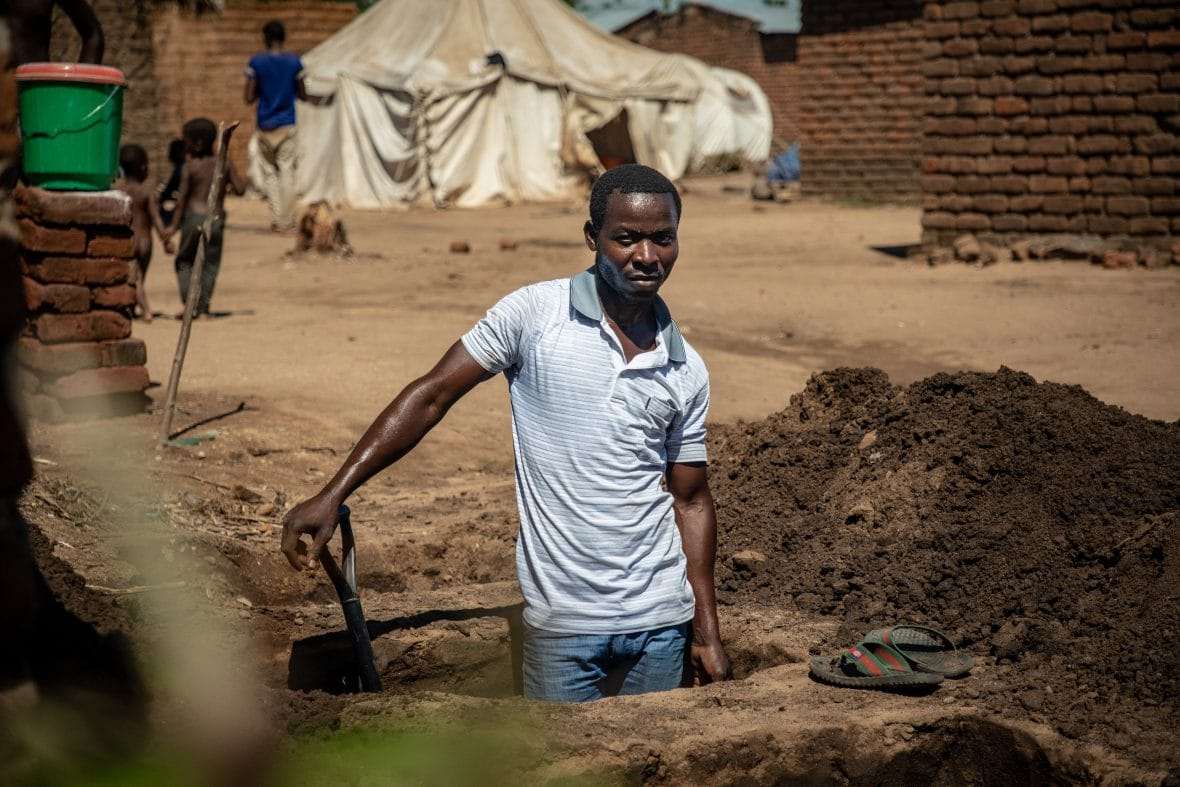 digging latrines at the Nyachikadza Displacement Camp