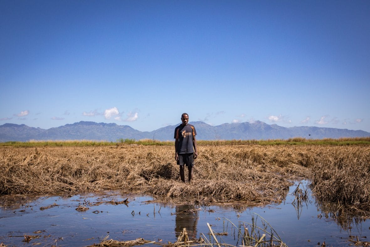 Recently married Patrick Ghembo of Monyo Village, Malawi, standing in his field, destroyed by the floods.