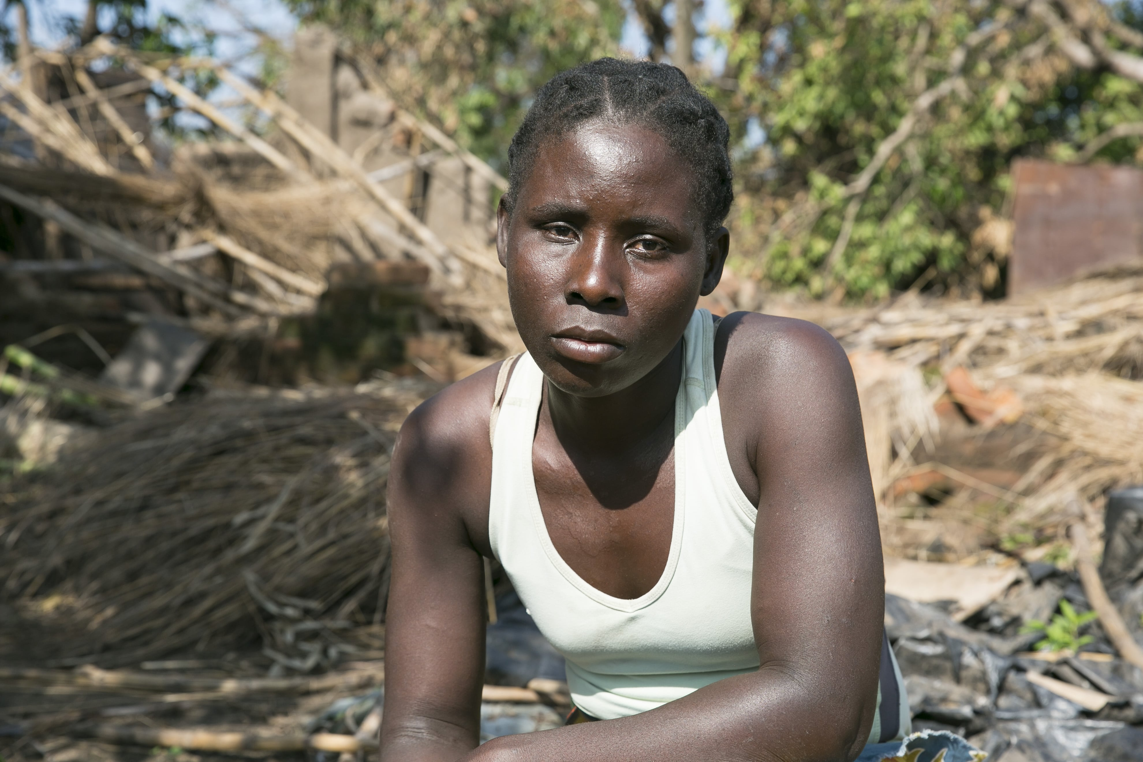 A woman iun fron of her Cyclone Idai destroyed home in Mozambique