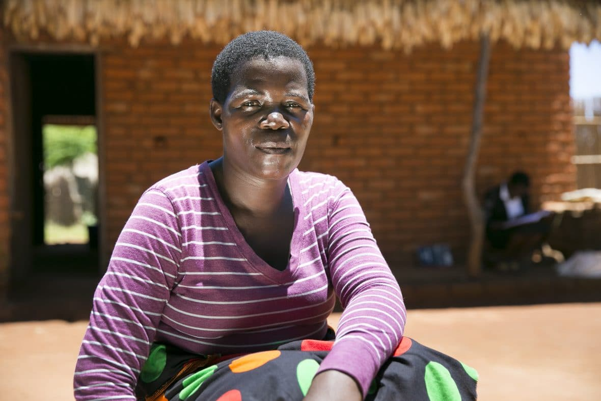 Stawa James at her new home in the village of Chituke in Mangochi District, Malawi. Stawa says her family's circumstances have improved dramatically since she started using conservation agriculture. Concern has been carrying out conservation agriculture programming in Malawi since 2012, with the assistance of Accenture Ireland.