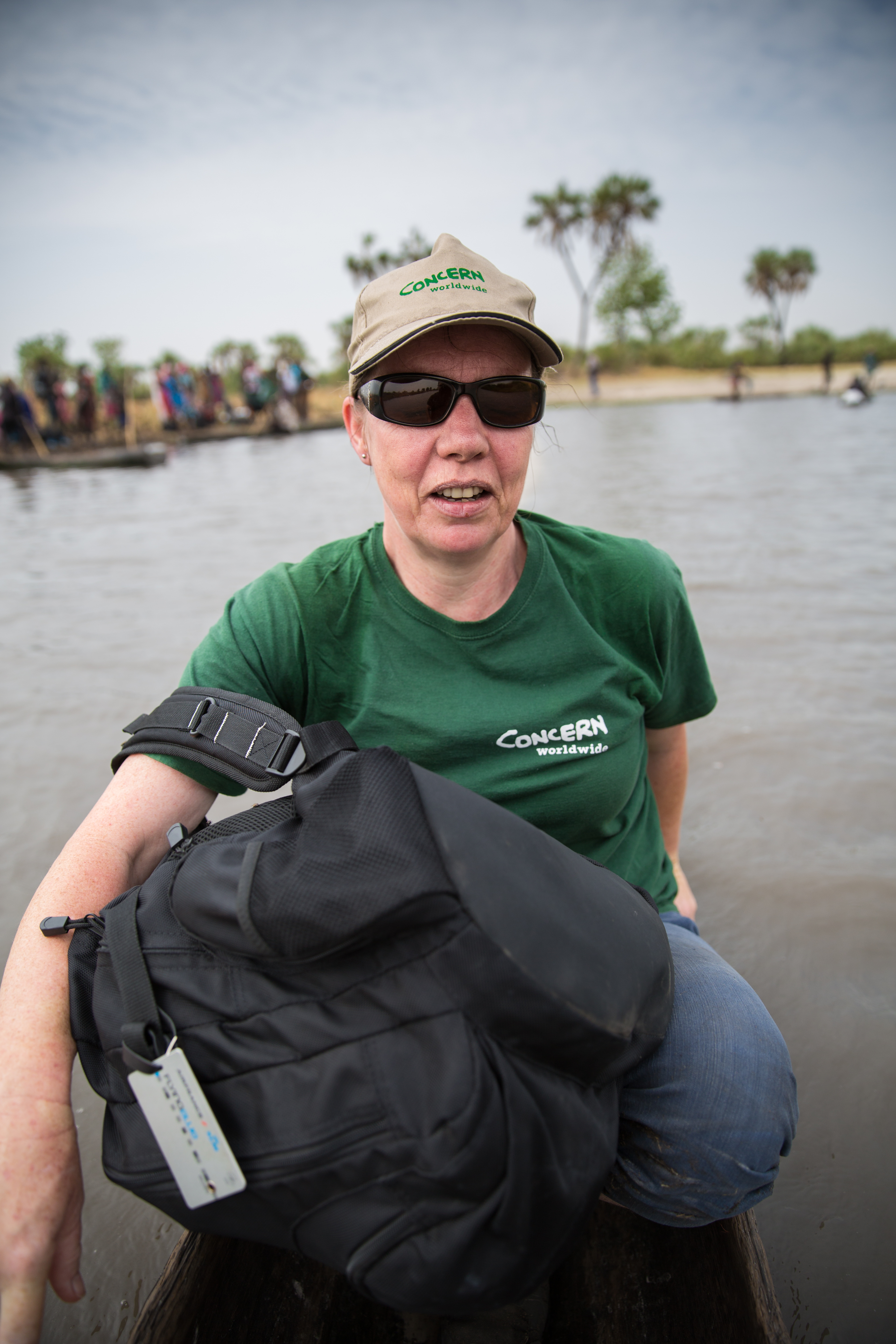 Nellie Kingston of Concern Worldwide travels by dugout canoe through a swamp in South Sudan.