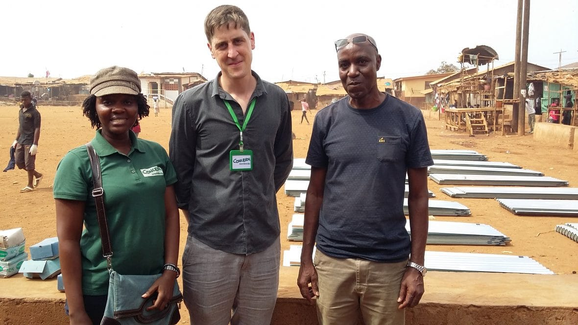 Concern Worldwide staff Aminata Musa-Phorah, Eoin O'Donnell and Dan Otieno at a distribution point near the fire affected site.