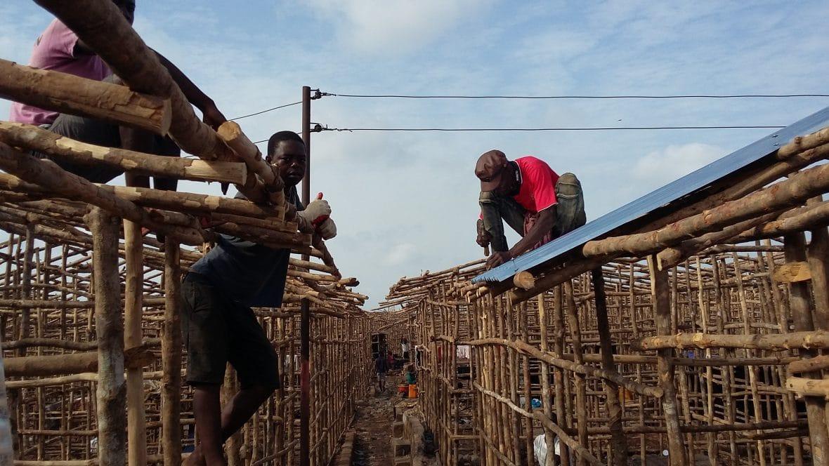 Residents rebuilding their homes after Concern donated materials needed at the Kroo Bay slum in Freetown.