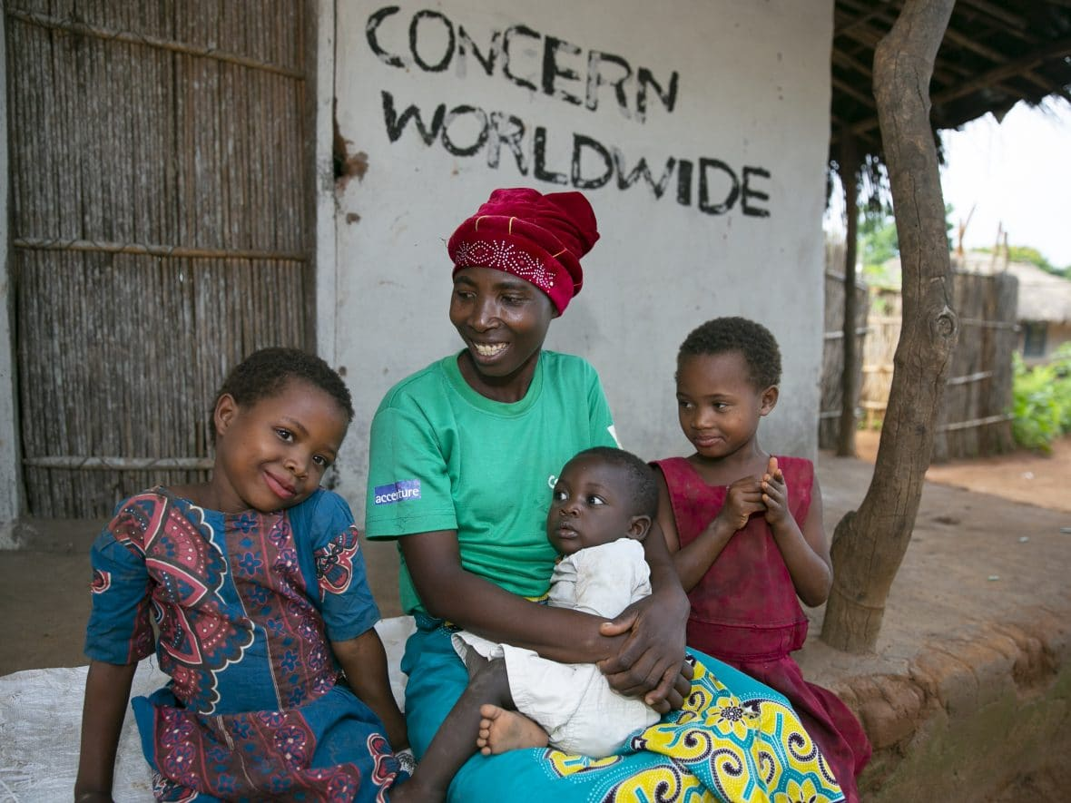 Esime Jenaia with her children at their home in Mangochi district, Malawi.