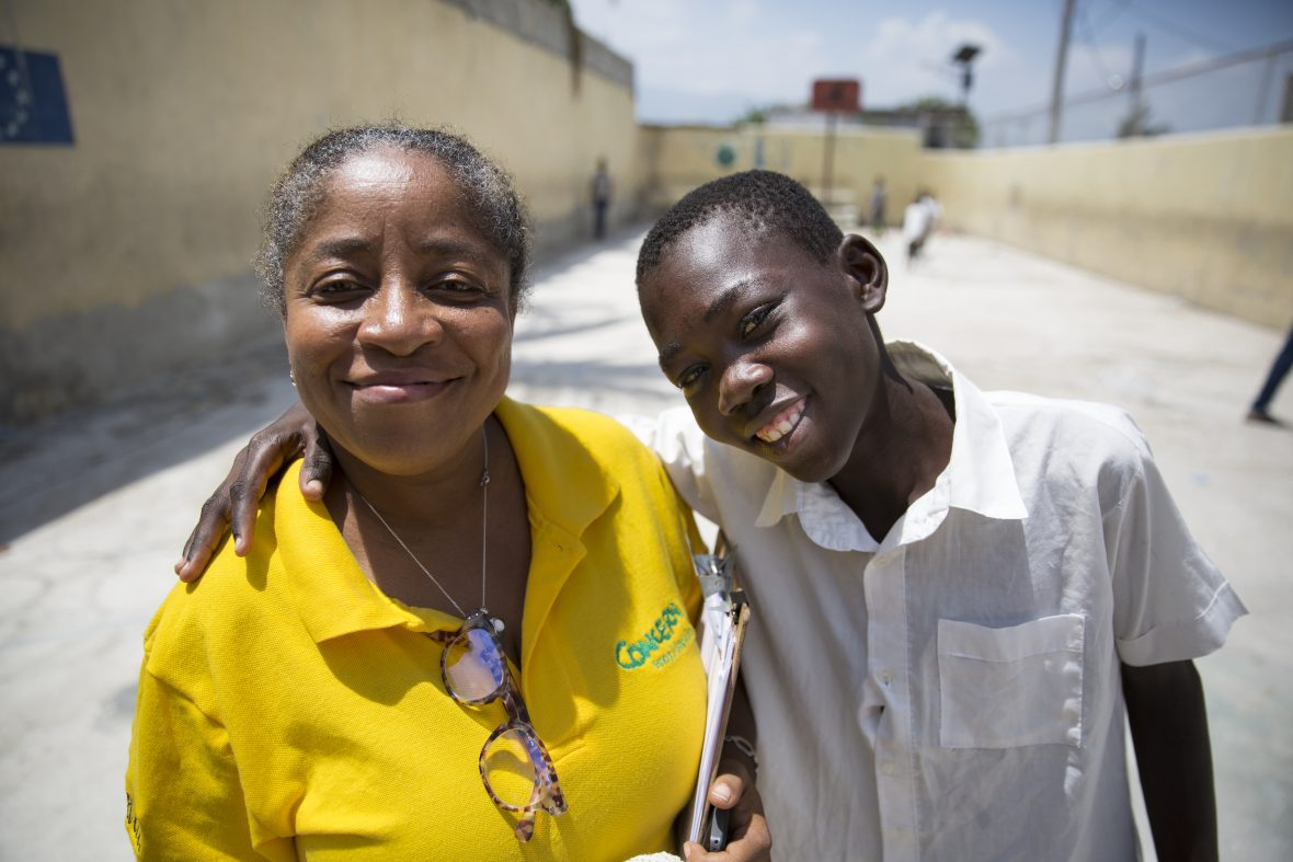 A facilitator and a yound man at a summer camp in Haiti