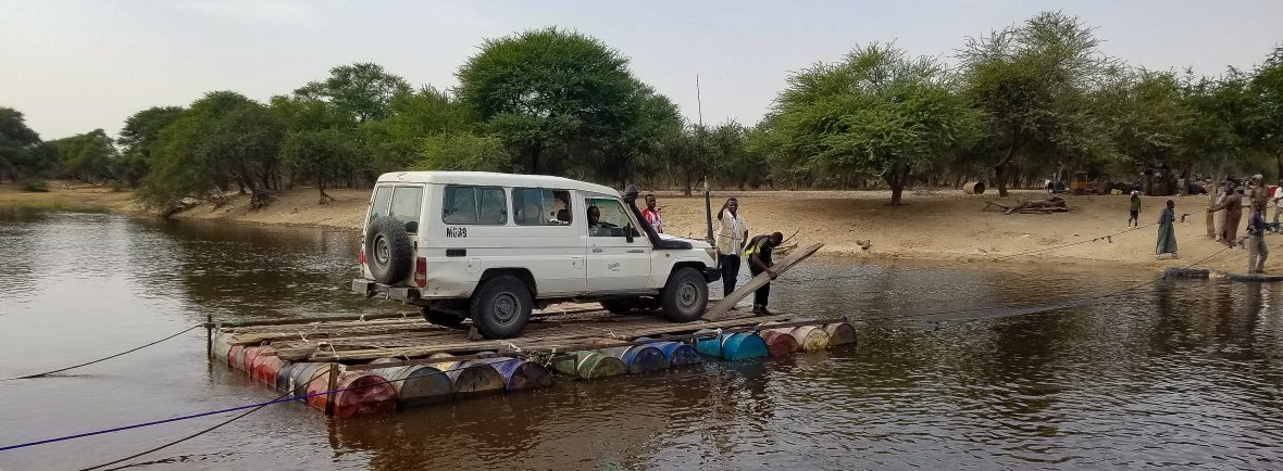 A Land Crusier on a raft in Chad