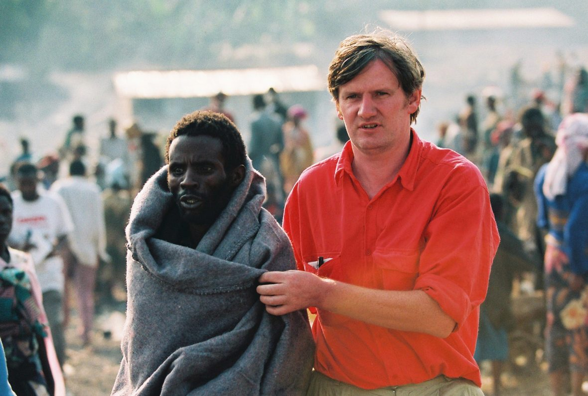 Aid worker in Rwanda with a refugee
