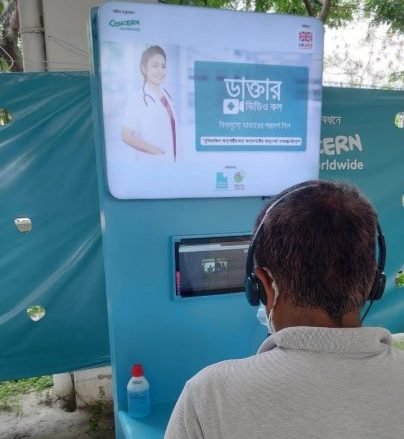 A video consultation at a mobile COVID-19 screening and sampling station in Dhaka