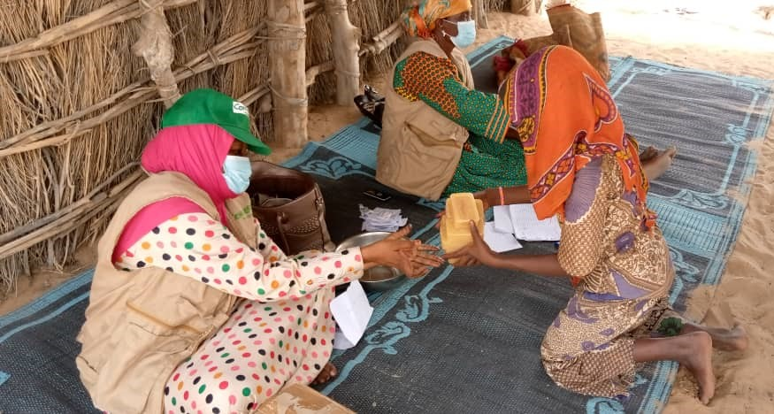 Women distributing soap in Chad