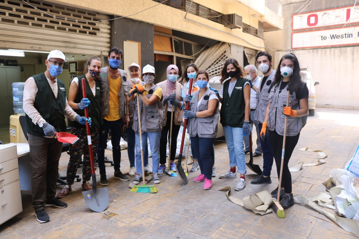 A group of aid workers responding to the explosion in Beirut with cleanup efforts