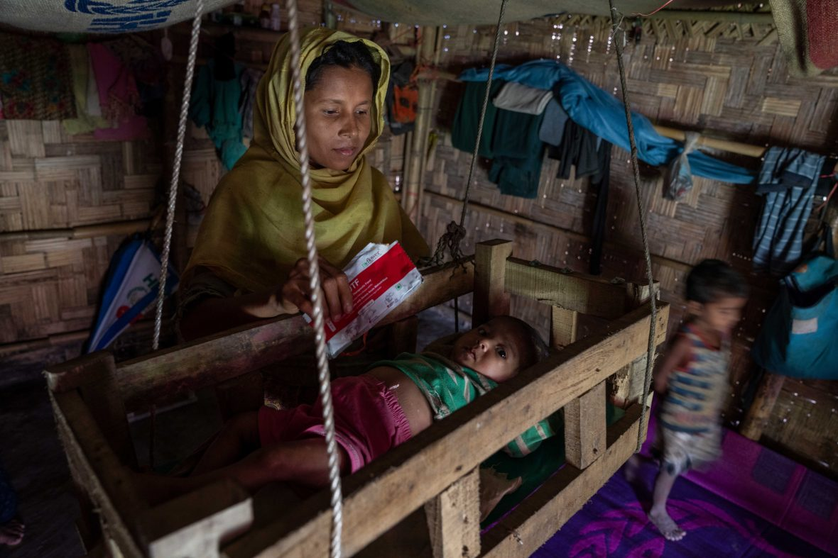 A mother and children in a Rohingya refugee camp