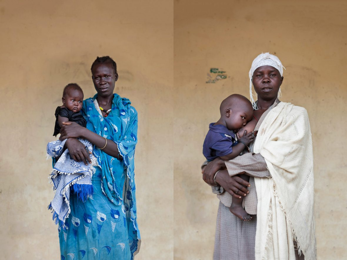 Two South Sudanese women with their babies, being treated at a maternal and child health clinic