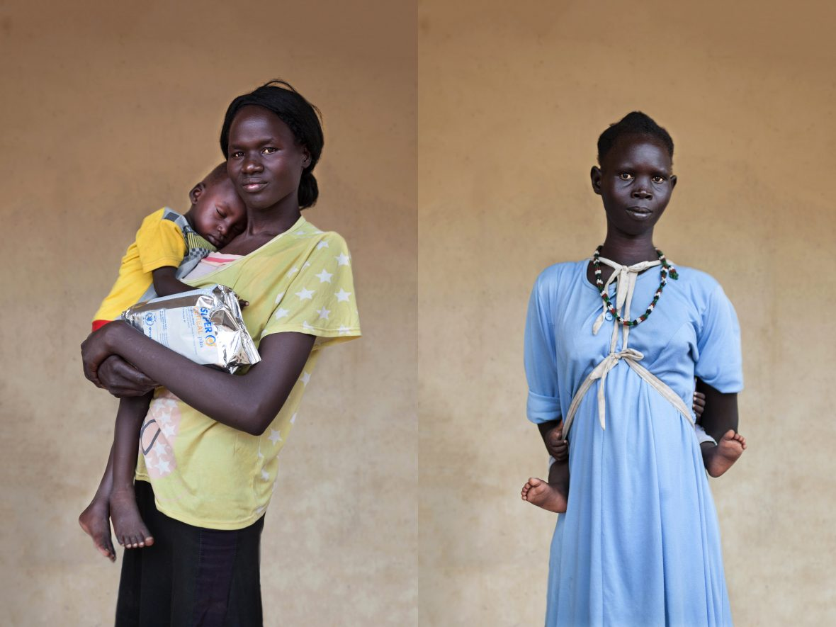 Two South Sudanese mothers and their children outside of a health clinic in Northern Bahr el Ghazal